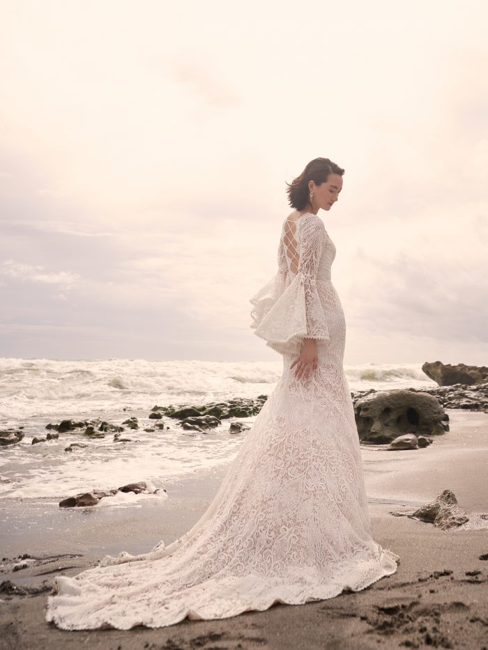 Model Wearing Vintage Lace Wedding Dress with Bell Sleeves and Rope Corset Called Benson by Sottero and Midgley