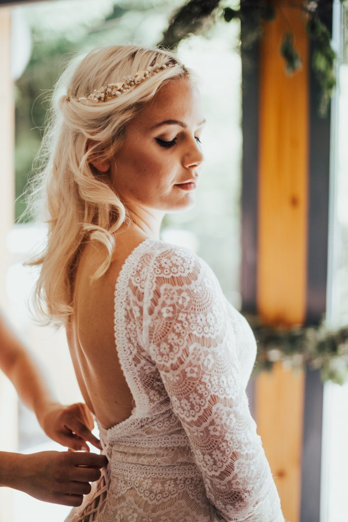 Real Bride Getting Dressed for Her Wedding and Wearing Maggie Sottero Wedding Dress Deirdre