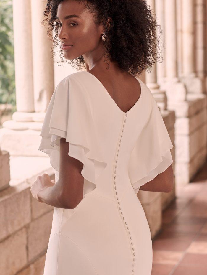 Bride Wearing Modest Flutter Sleeve Wedding Dress Called Adele by Maggie Sottero
