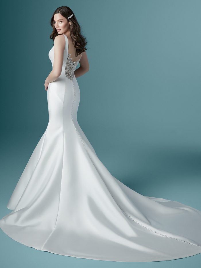Model Wearing Simple Satin Mermaid Wedding Dress Called Ladelle by Maggie Sottero