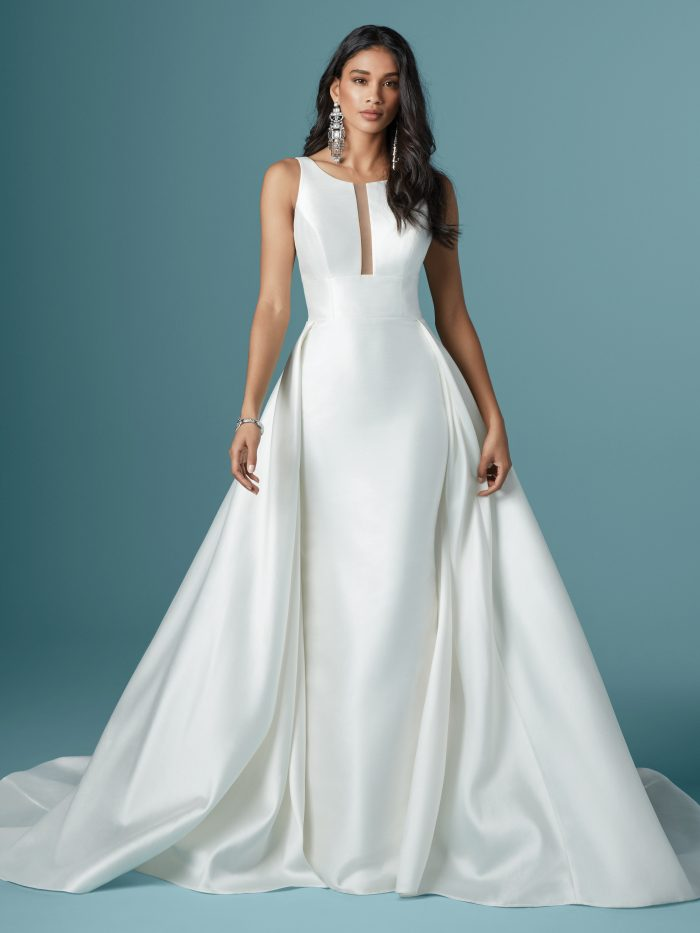 Model Wearing Striking Satin Iconic Movie Wedding Dress with Attached Over Skirt Called Rhiannon by Maggie Sottero