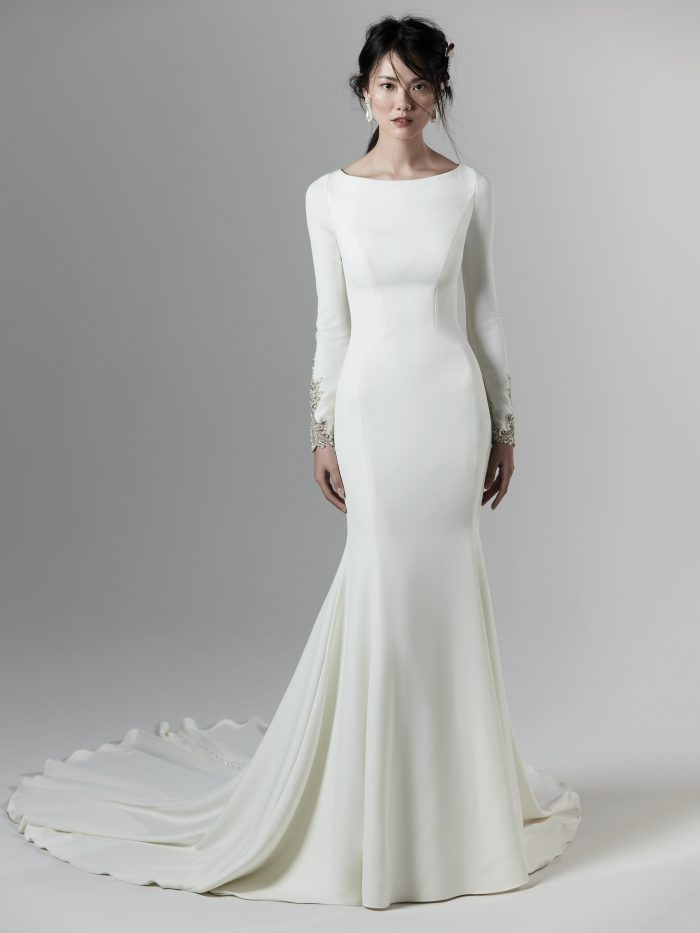 Bride Wearing Long Sleeve Crepe Wedding Dress Called Aston by Sottero and Midgley