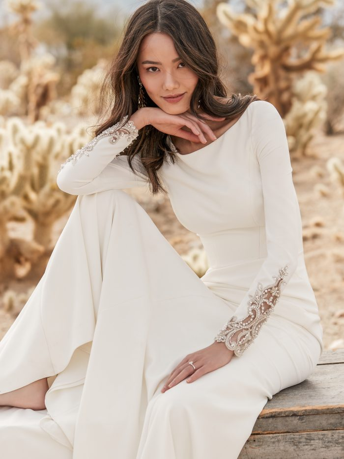 Bride Wearing Long Sleeve Crepe Wedding Dress with Embroidered Back Called Aston by Sottero and Midgley