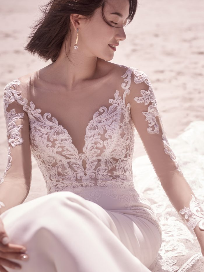 Bride Wearing Long Sleeve Crepe Wedding Dress Called Cambridge Dawn by Sottero and Midgley