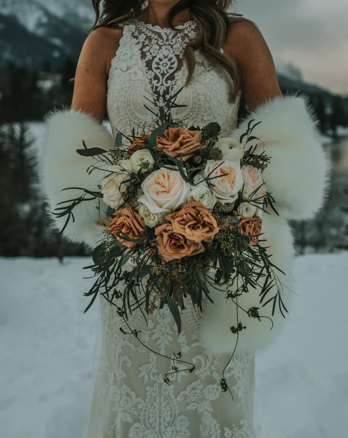 Real Bride in the Winter Holding Bridal Bouquet With White and Toffee Roses