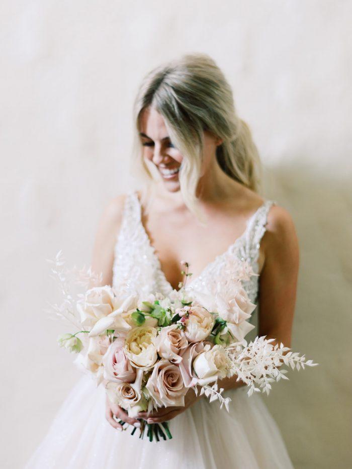 Real Bride Wearing Princess Boho Wedding Dress and Holding Boho Wedding Bouquet