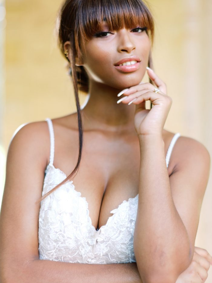 Black Model Wearing Whimsical Bohemian Wedding Dress Called Stevie by Maggie Sottero