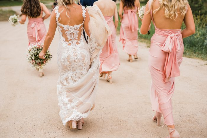 Real Bride and Bridesmaids and Maid of Honor walking to the wedding featuring Abbie a Lace Sexy Back wedding dress by Maggie Sottero