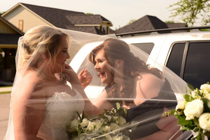 Maid of Honor and Real Bride wearing Jennifer lace wedding dress by Rebecca Ingram