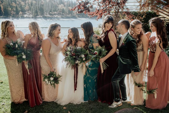 Real Bride wearing Lavonne sheath wedding dress by Rebecca Ingram with her bridesmaids and Maid of Honor