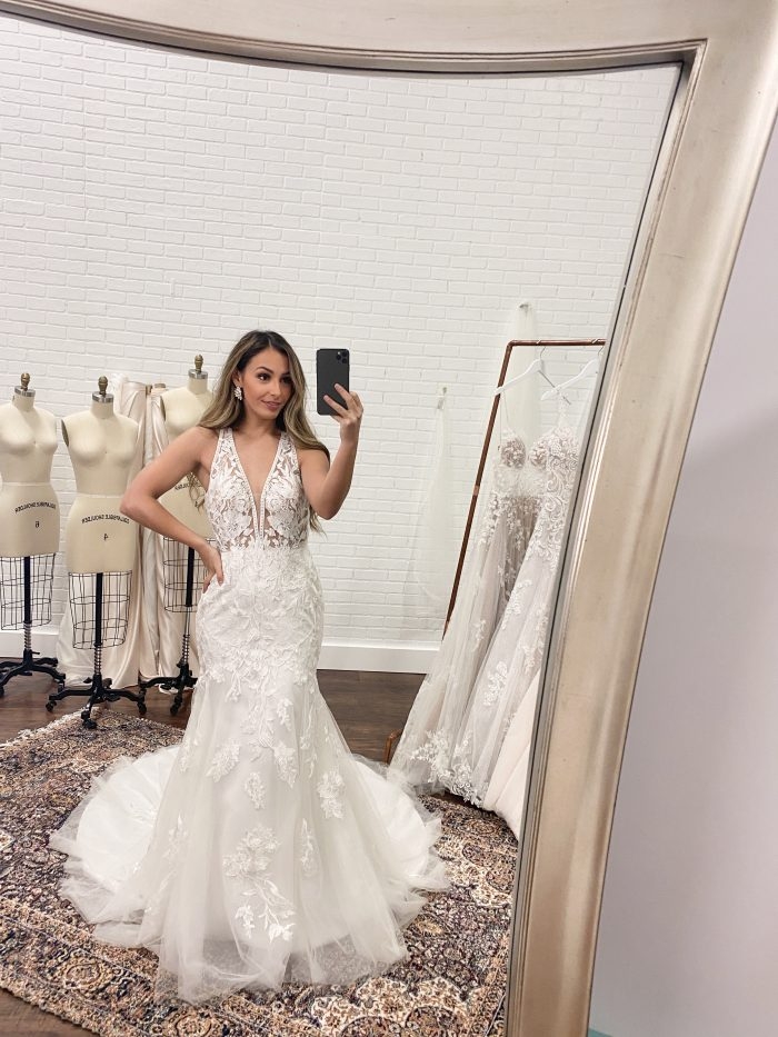 Bride Taking a Selfie in the Mirror During Her Wedding Dress FItting