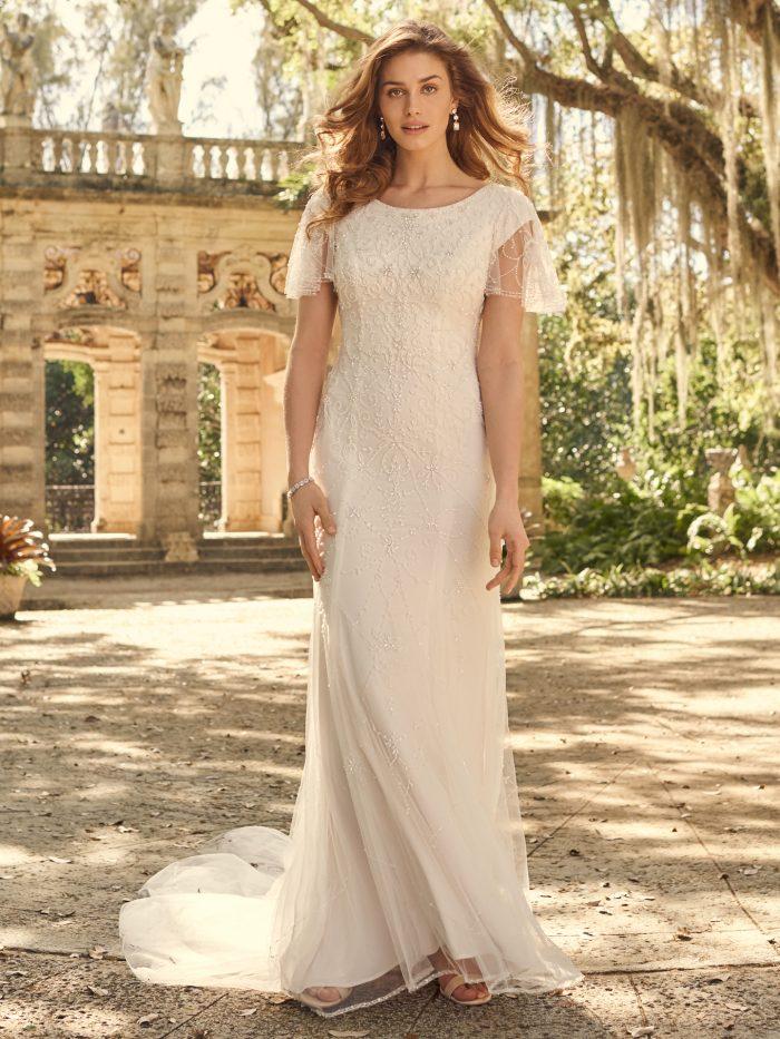 Bride Wearing Modest Flutter Sleeve Wedding Gown Called Garnett by Maggie Sottero