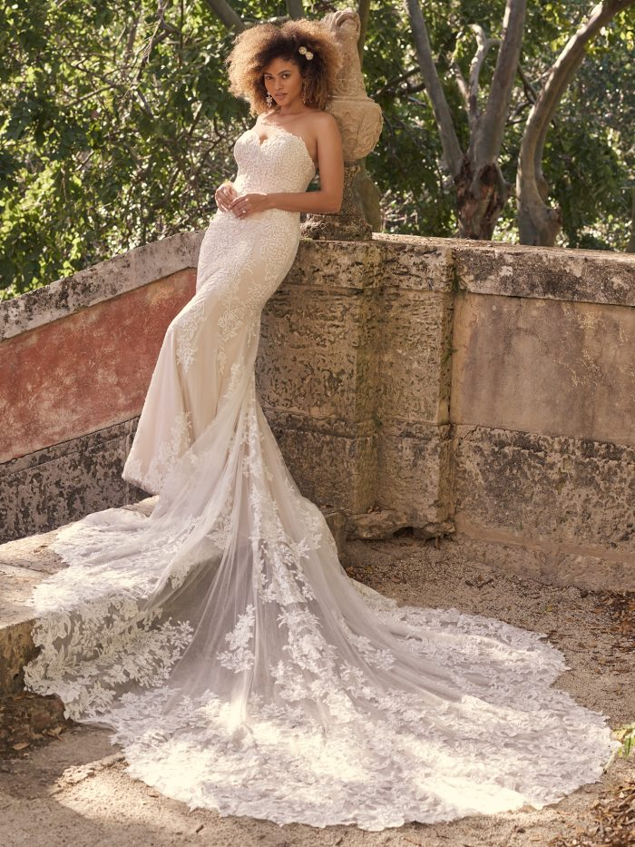 Bride Wearing Glamorous Strapless Wedding Dress with Long Train Called Katell by Maggie Sottero