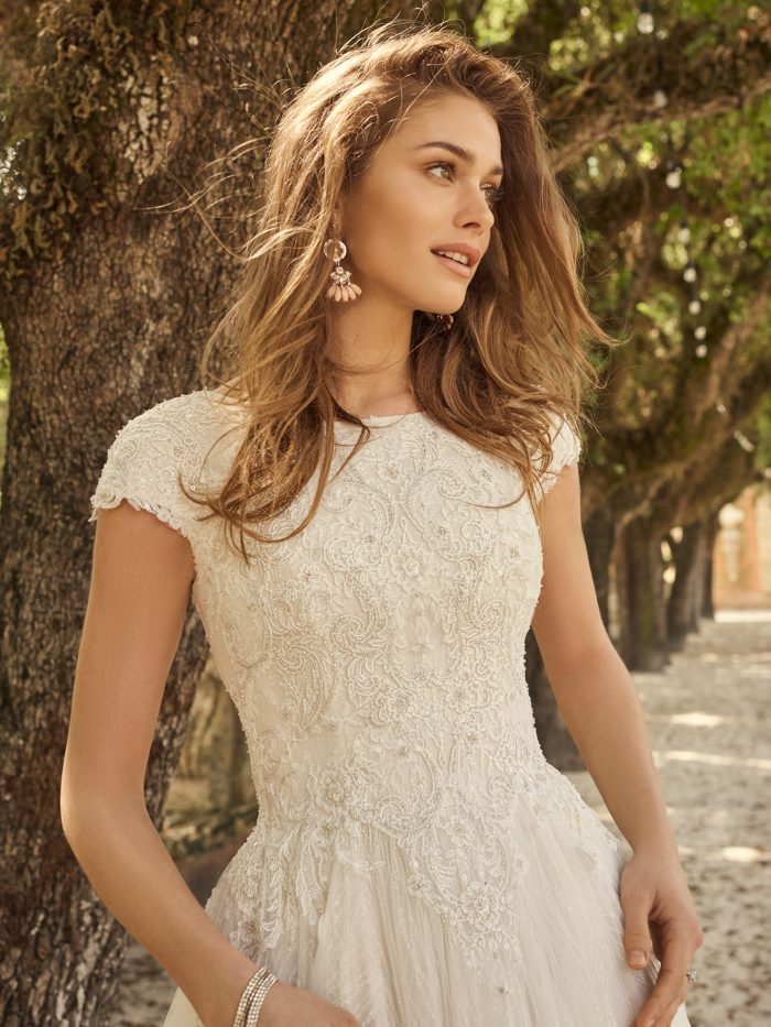 Bride Wearing Modest Cap-Sleeve Princess Wedding Dress Called Pearson by Maggie Sottero