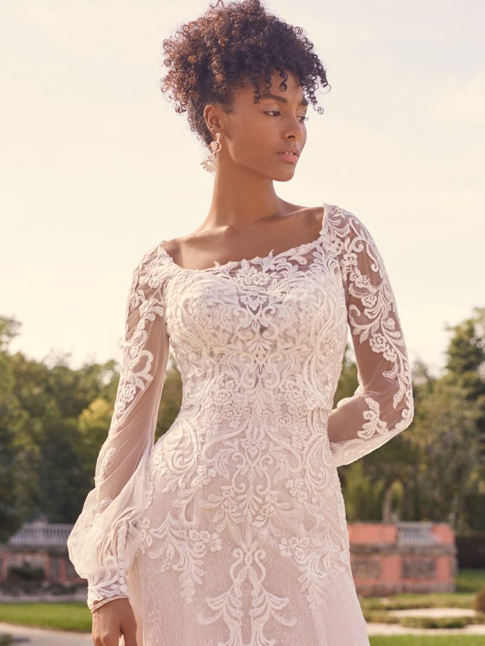 Bride Wearing Lace Bridal Jacket Over Strapless Wedding Dress Called Sedona by Maggie Sottero