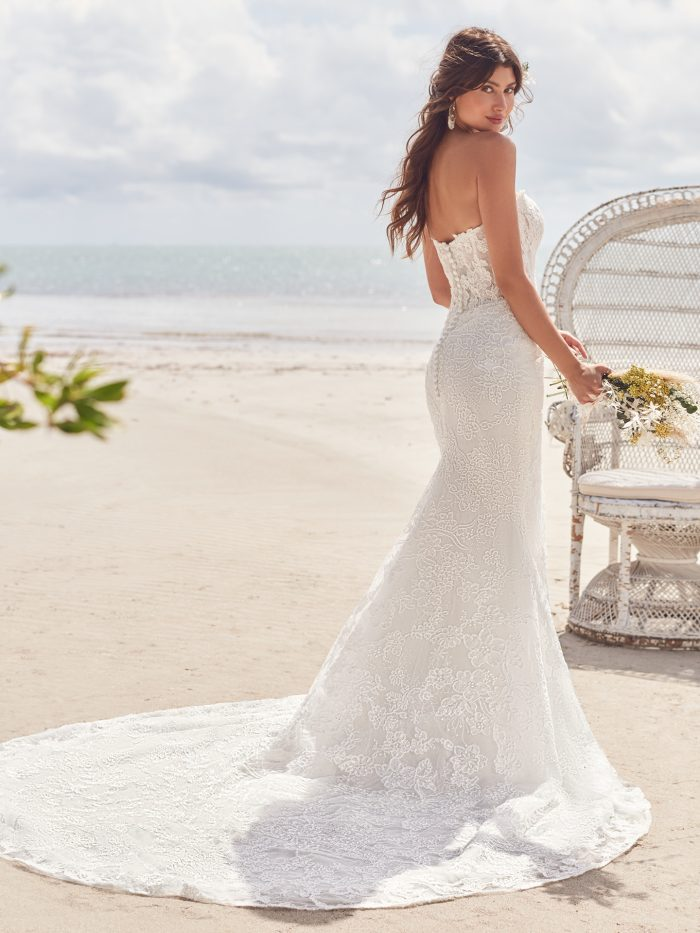 Bride Wearing Affordable Strapless Wedding Dress Called Dallas by Rebecca Ingram