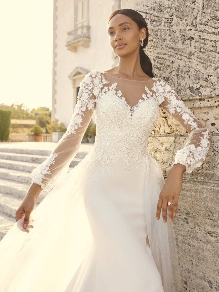 Bride Wearing 3-D Floral Lace Bishop Sleeve Bridal Gown Called Arta by Sottero and Midgley