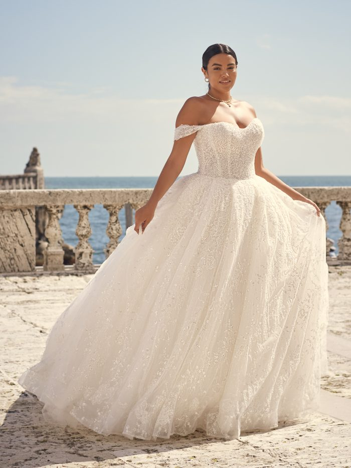 Bride Wearing Luxurious Off-the-Shoulder Sleeve Ball Gown Wedding Dress Called Zartasha by Sottero and Midgley