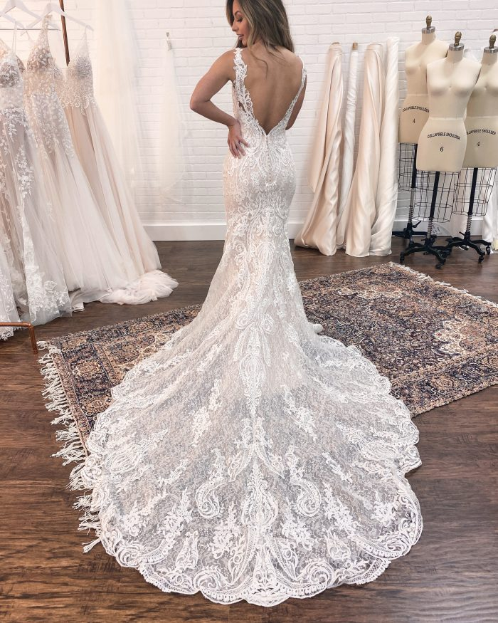 Bride Showing the Back of Her Maggie Sottero Wedding Dress Train at Wedding Dress Fitting
