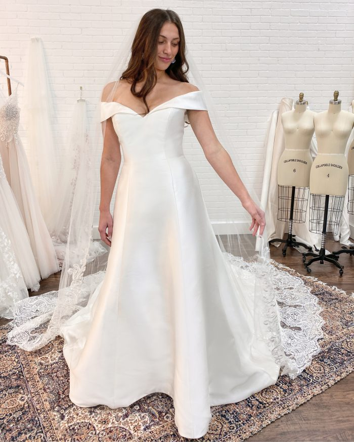 Bride Wearing Satin A-line Wedding Dress Called Coral by Rebecca Ingram at Wedding Dress Fitting