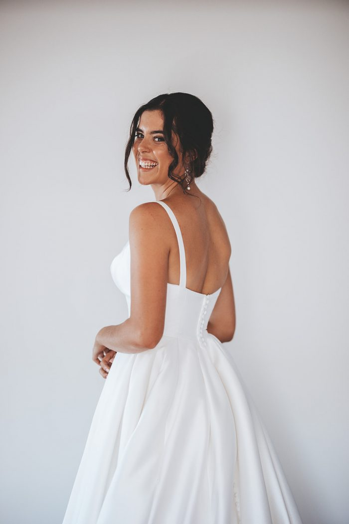 Bride Wearing Classic Wedding Makeup and Modern Satin Bridal Gown Called Selena by Maggie Sottero