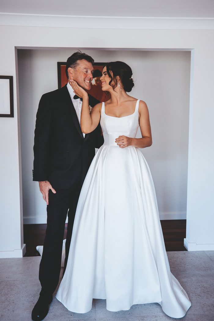 Father of the Bride with Bride Wearing Satin Ball Gown Wedding Dress by Maggie Sottero