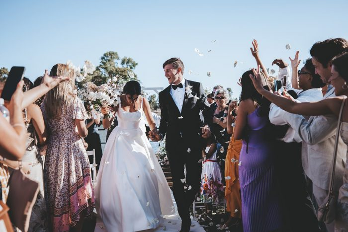 Bride and Groom Celebrating with Guests After Lakeside Wedding Ceremony in Western Australia