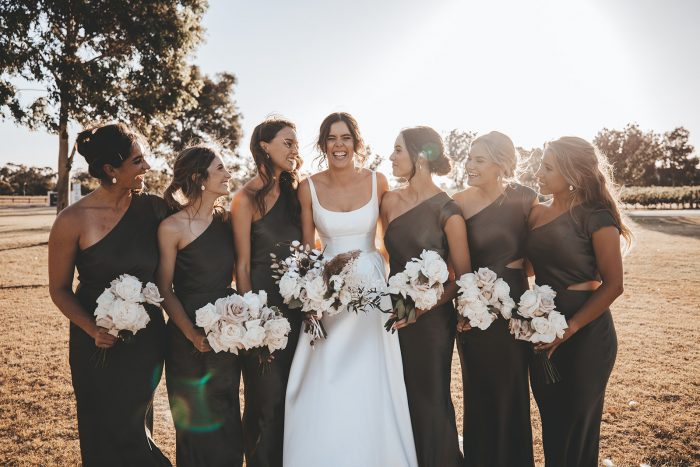 Bride in Satin Wedding Gown by Maggie Sottero with Bridesmaids Wearing Fern Green Bridesmaids Dresses