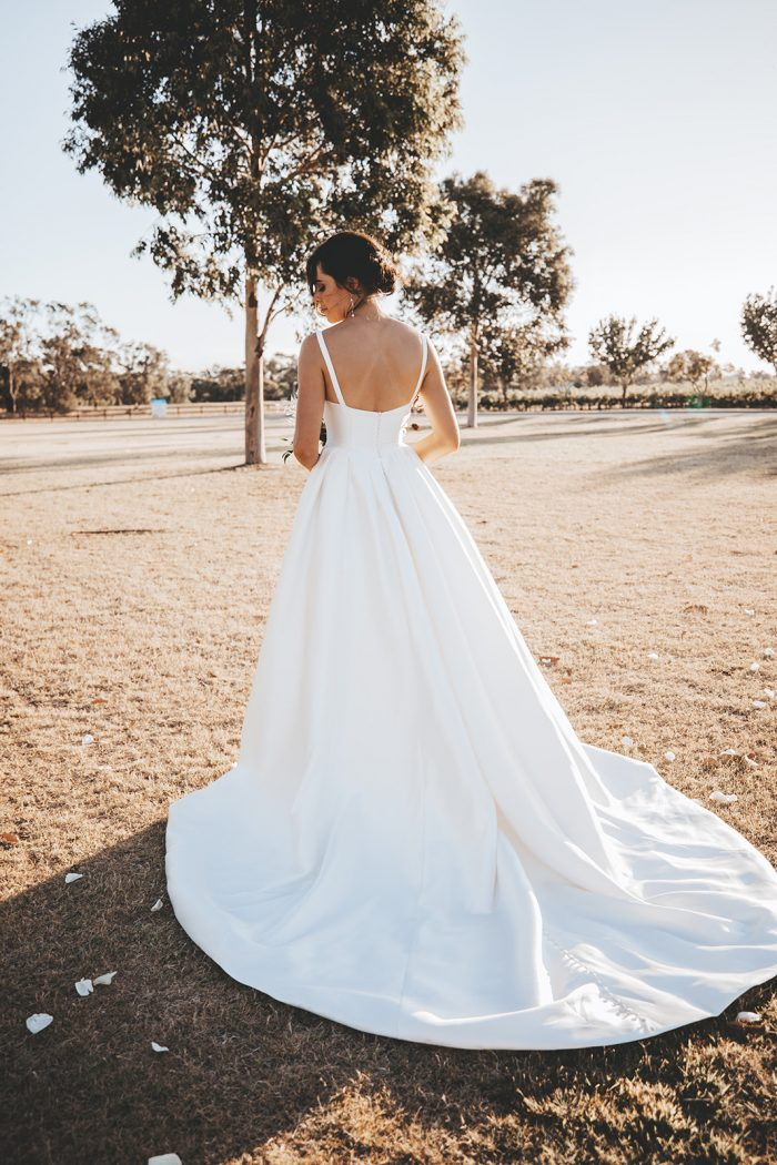 Bride From the Back Wearing Sleeveless Satin Ball Gown Wedding Dress Called Selena by Maggie Sottero