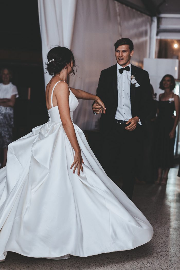 Groom Dancing with Bride Wearing Modern Satin Wedding Gown Called Selena by Maggie Sottero