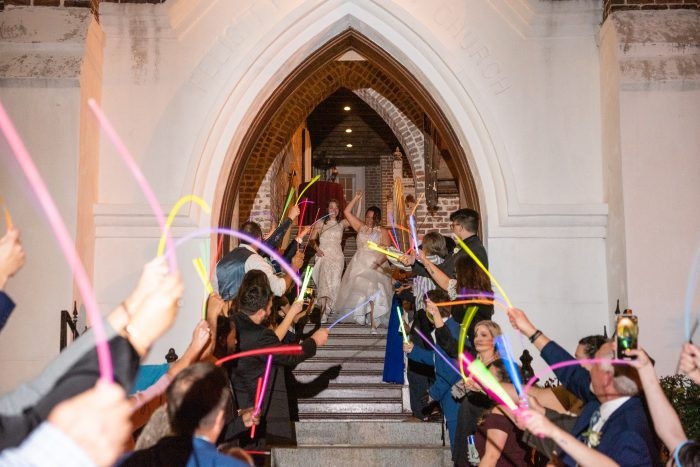 Pride Wedding Idea of Using Glow Sticks for Wedding Send Off