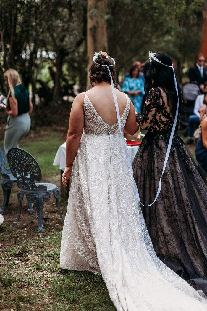 LGBTQ Brides Doing Greek Orthodox Wedding Crowing Ceremony While Wearing Maggie Sottero Wedding Dresses