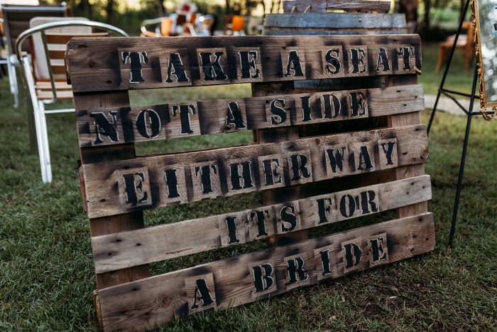 Sign at LGBTQ Wedding That Says Take a Seat Not a Side