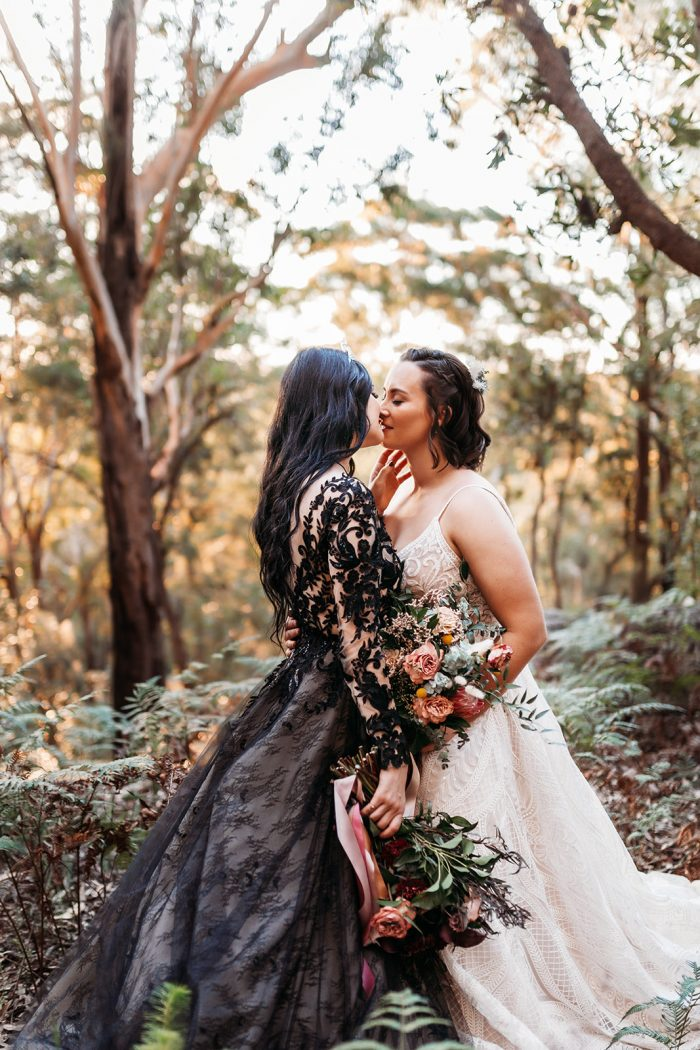 LGBTQ Brides at Fairytale Wedding Wearing Contrasting Black and Ivory Wedding Dresses by Maggie Sottero