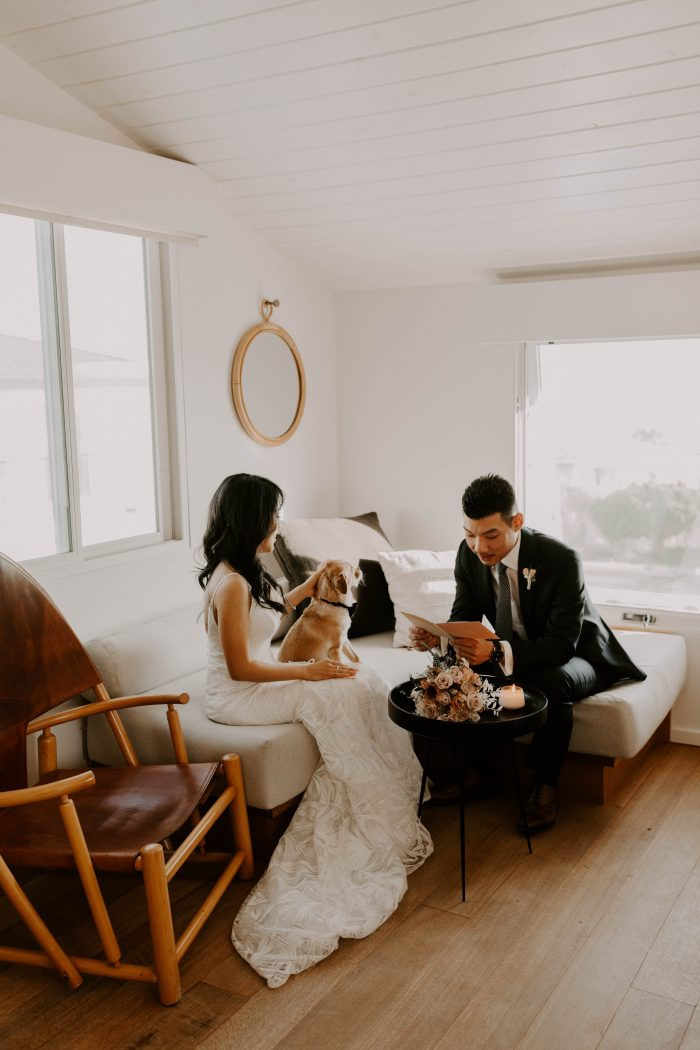 Bride and Room in Hotel Room Exchanging Vows Before Casual Beach Wedding