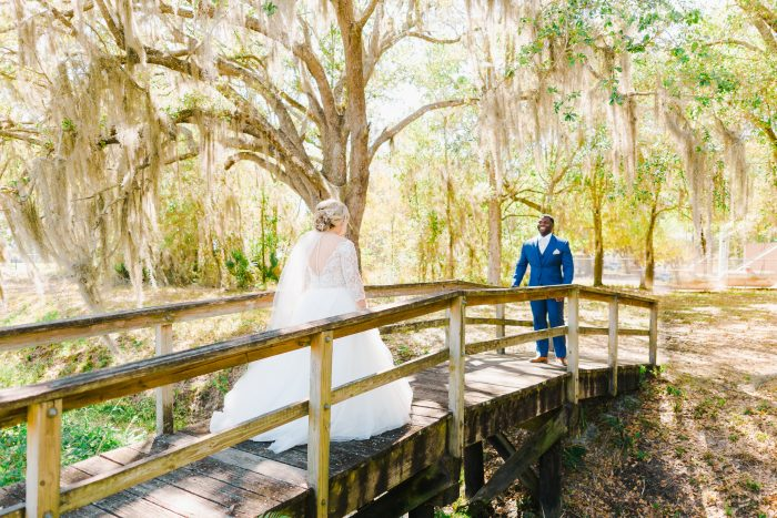 Bride in Maggie Sottero Wedding Dress with Groom Doing Wedding First Look