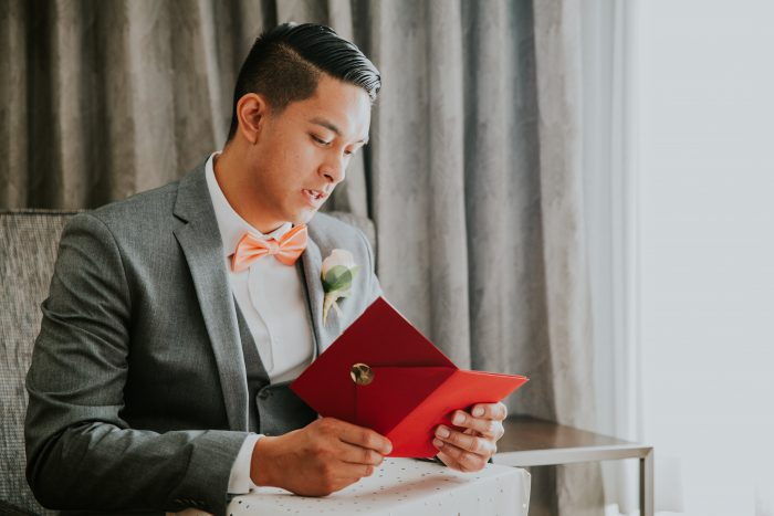 Groom Opening Pre-Wedding Gift That's One of Our Wedding Gift Ideas for Grooms