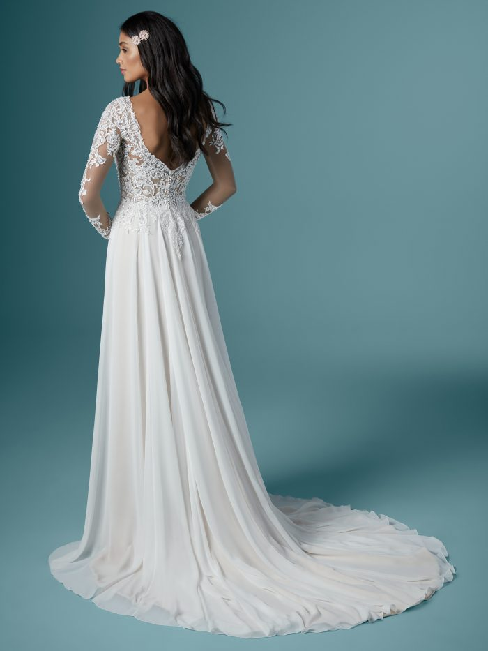 Bride Wearing Long Sleeve Chiffon Wedding Dress Called Madilyn by Maggie Sottero