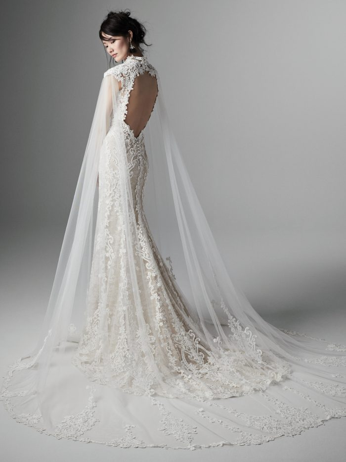 Bride Wearing Elegant Vintage Lace Wedding Dress with Keyhole Back and Tulle Cape Called Zinnia by Sottero and Midgley