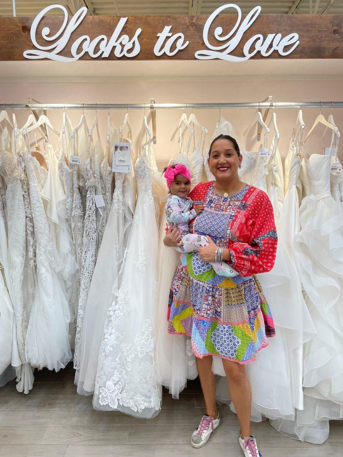 Ella Blu Bridal Boutique Owner Holding A Baby