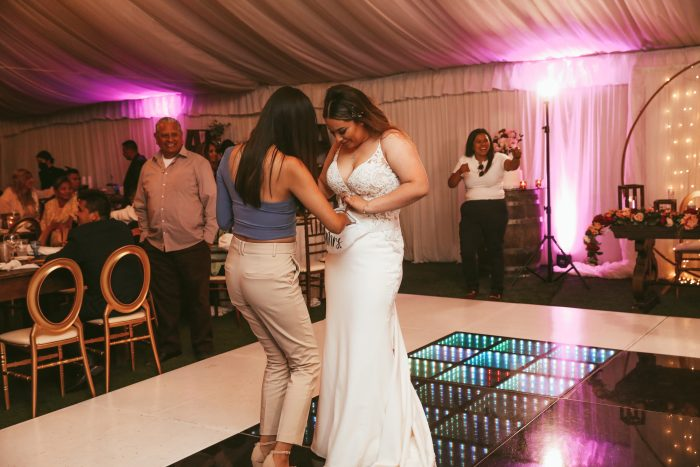 Hispanic Bride Accepting Money From The Money Dance