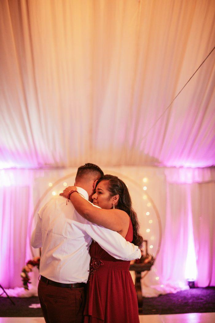 Los Padrinos Dancing at Hispanic Wedding
