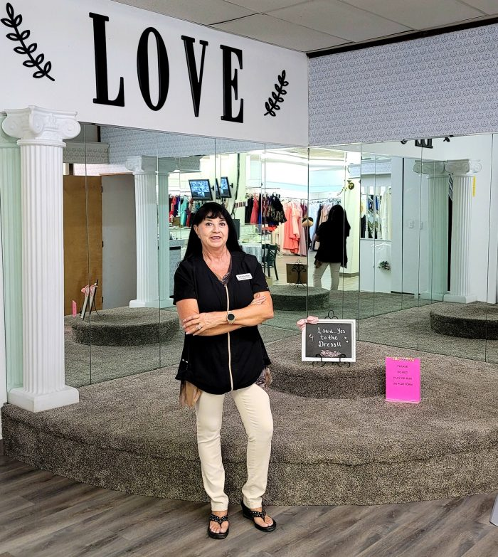 Jae-Geos Bridal and Tuxedo Owner In Her Boutique