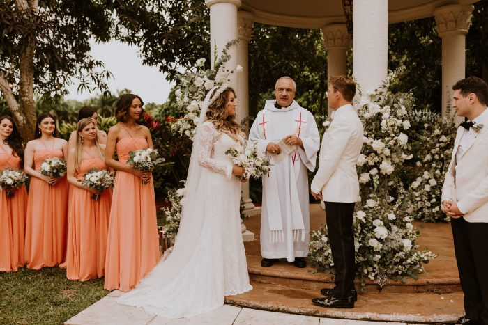 Hispanic Bride and Groom Standing at the Altar with a Priest