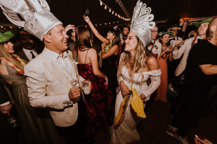 Hispanic Bride Dancing with Groom Wearing Wedding Dress Called Antonia by Maggie Sottero