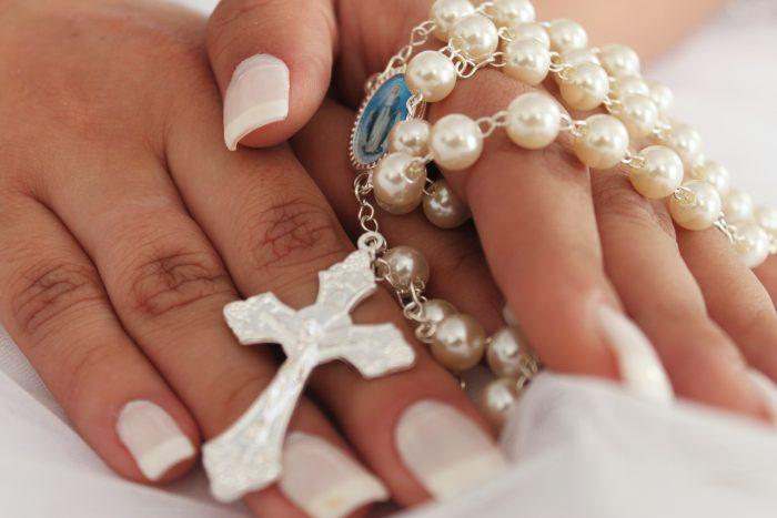 Bride Holding a Rosary for El Lazo Hispanic Tradition